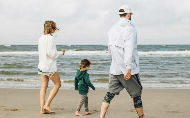 Jessica Biel, Justin Timberlake, and Silas walking on a beach in the Netherlands