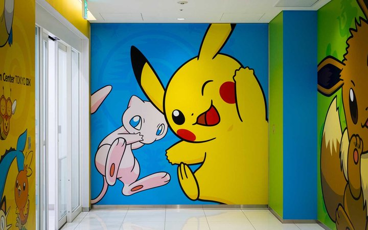 A mural of Mew and Pikachu, two popular Pokemon characters, at the Pokemon Center Tokyo DX (Pokemon Center DX). Nihombashi, Tokyo, Japan.