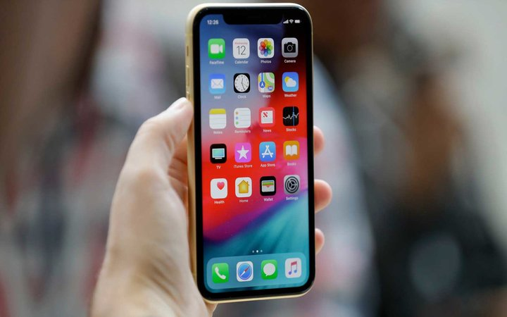 The new Apple iPhone XR is on display at the Steve Jobs Theater after an event to announce new products, in Cupertino, Calif Apple Showcase, Cupertino, USA - 12 Sep 2018