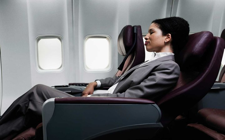 Woman in business class seat on a plane