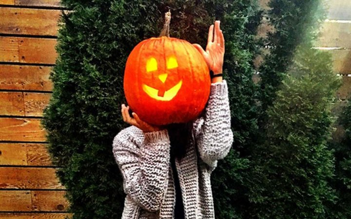 Meghan Markle poses with a pumpkin for Halloween
