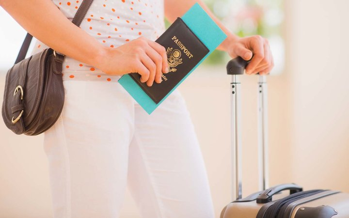 USA, New Jersey, Jersey City, Close up of woman with luggage and passport