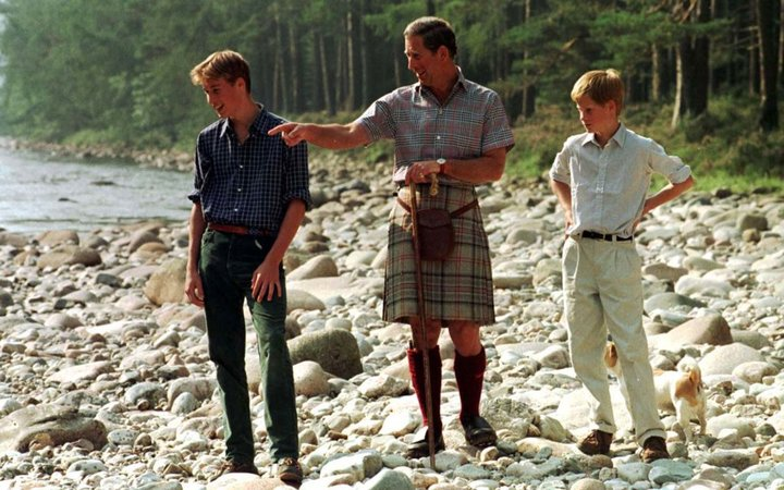 The Prince of Wales and his sons Prince William, 15, and Harry, 12, take an early morning walk along the banks of the River Dee on the Balmoral Estate today