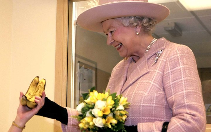 Queen Elizabeth II; presented with a bunch of bananas by Elizabeth Hyde during a visit to the Queen Elizabeth Hospital, King's Lynn in Norfolk, eastern England, 24 January 2008
