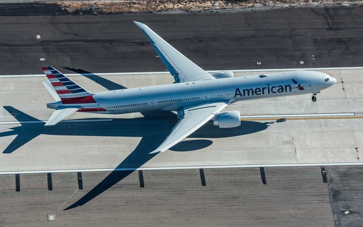 An American Airlines Boeing 777 at Los Angeles Int. Airport seen from a helicopter