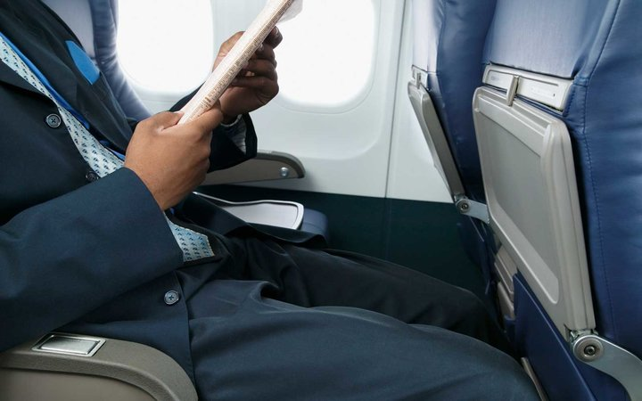 Sit in the middle seat on a flight this holiday season and you can win a variety of prizes.