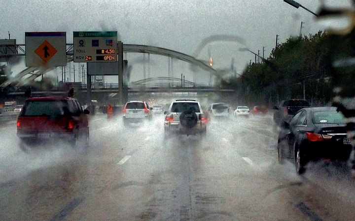 Automobile traffic in heavy rain on a freeway in Houston, TX
