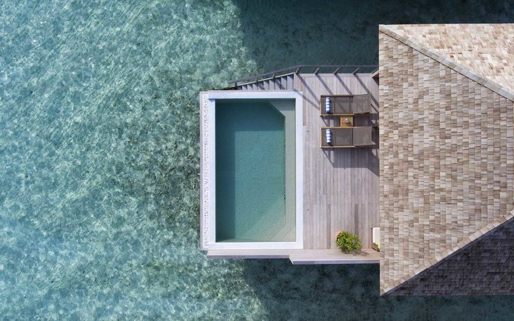 Aerial view of an overwater pool at the Hurawalhi resort in the Maldives