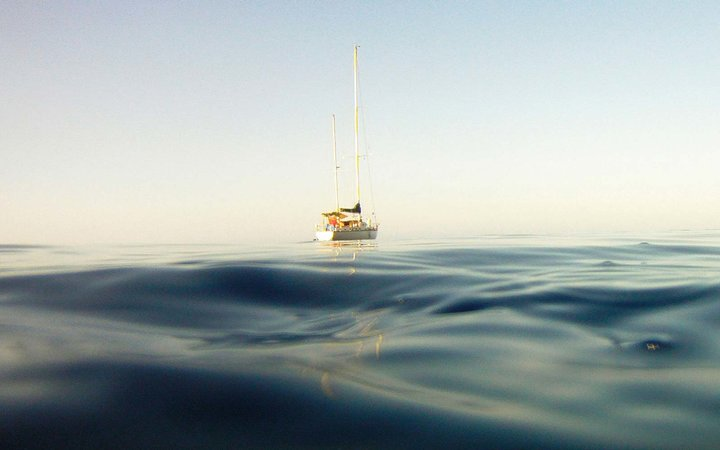 Sailboat in the middle of the sea
