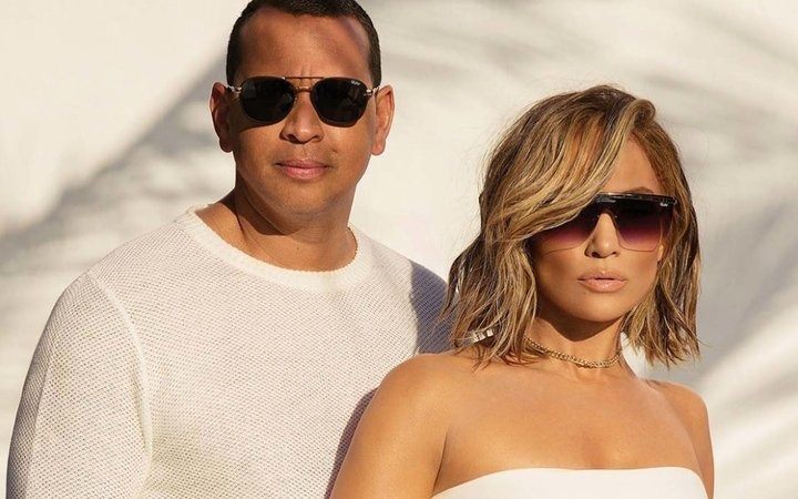Jennifer Lopez and Alexander Rodriguez wearing Quay sunglasses