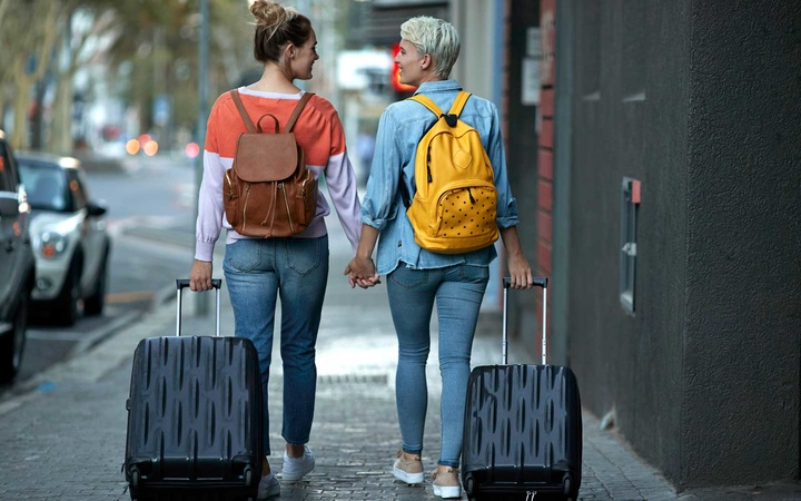 Couple with travel gear