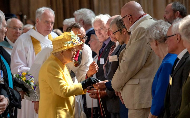 Queen Elizabeth II distributes the Maundy money at the traditional Royal Maundy Service at St George's Chapel