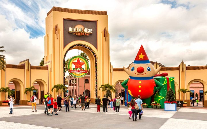 Arch at entrance to Universal Studios theme park in Orlando, Florida decorated for the Christmas holiday season