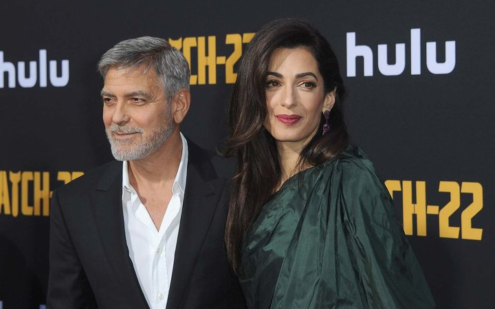 George Clooney and Amal Clooney arrive for the U.S. Premiere Of Hulu's  Catch-22  held at TCL Chinese Theatre