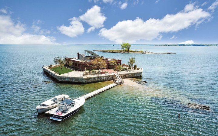 Shot of boat and private residence on private island.