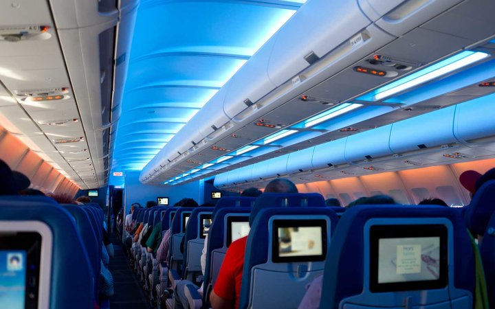 Airplane with entertainment screens