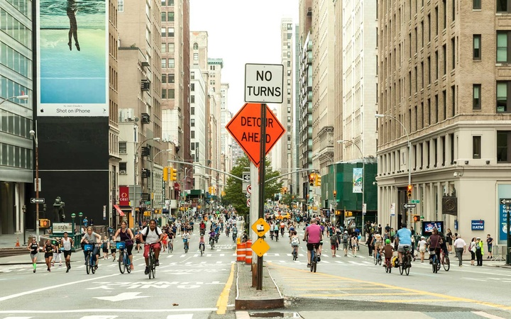 New Yorkers and tourists enjoy traffic free Summer Streets along Park Avenue to play, run, walk, bike modeled after Bogota & Paris.