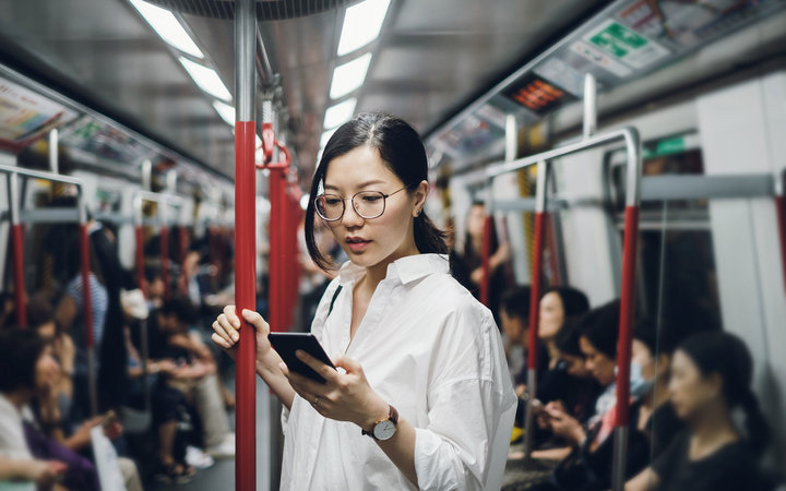 Woman uses cell phone abroad