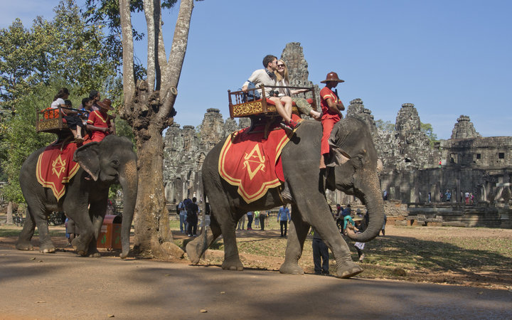 Tourists riding elephants in Angkor Wat