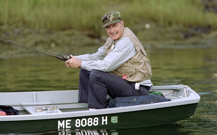 US President George Bush fishes on the Kennebunk River on August 27, 1990. Bush is scheduled to...