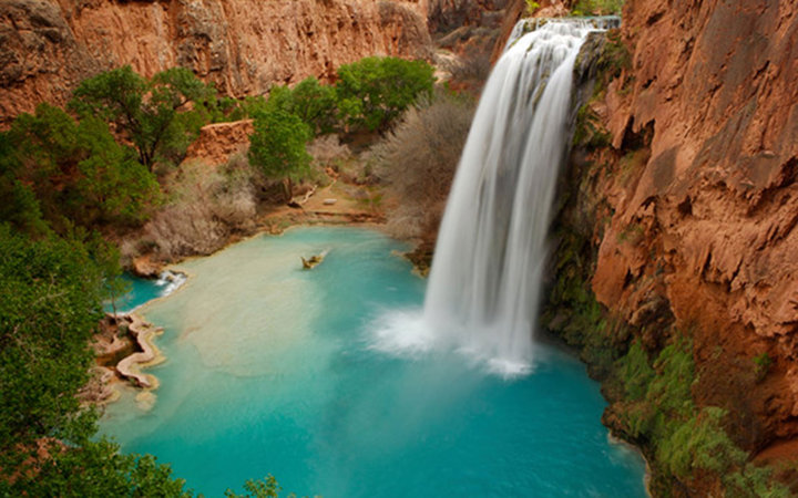 grand water fall and swimming hole in Havasu Falls, Supai, AZ