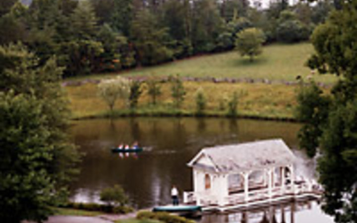 Buff Strickland A view of Old Walland Pond and its boathouse, at Blackberry Farm, outside Knoxville.