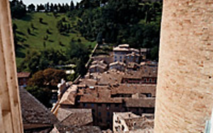 Simon Watson A view of Urbino's tiled rooftops, from the studiolo in the Palazzo Ducale.