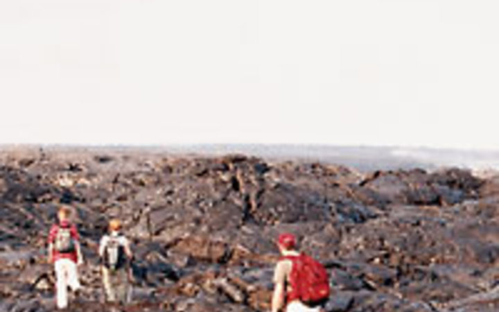 Dave Lauridsen A trek across cooled lava fields in Hawaii Volcano National Park.