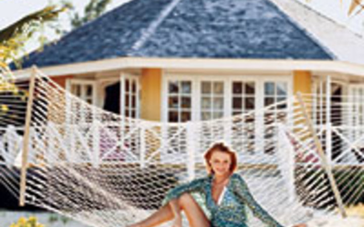 Ericka McConnell In front of a guest cottage at Kamalame Cay in the Bahamas.