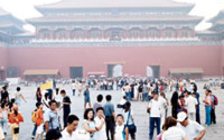 Dean Kaufman Tourists gather in the Forbidden City.