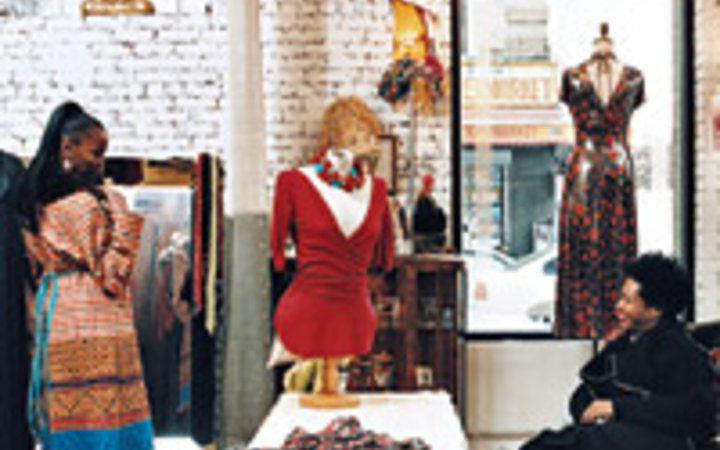 Kevin Cooley Montgomery Harris and a client in her Harlem shop, Montgomery