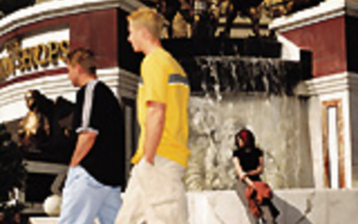 François Dischinger Teens hanging out in front of a Las Vegas fountain.