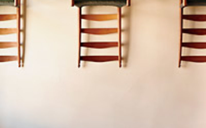 Ben Stechschulte Chairs hung for a cleaning at the Great Stone Dwelling, in Enfield, New Hampshire.