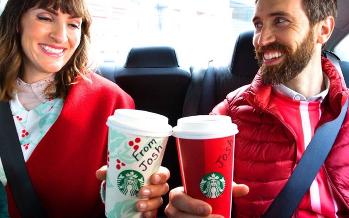Drinking Starbucks in the back of an Uber