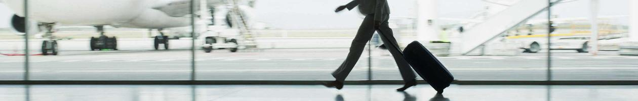 Business woman walking in airport