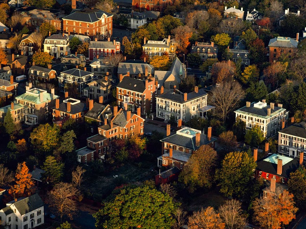 Aerials of Samuel McIntire Historic District of Federal mansions during peak autumn foliage in Salem, Massachusetts.
