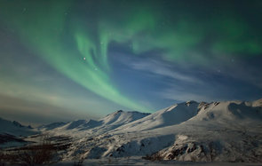 Aurora borealis dances over the klondike valley in tombstone territorial park