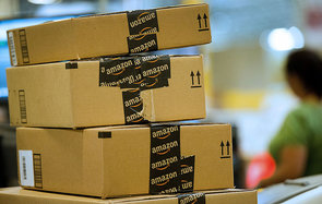 Boxes filled with merchandise sit stacked before shipment at the Amazon.com Inc. distribution center in Phoenix, Arizona, U.S. on Monday, Nov. 26, 2012. U.S. retailers are extending deals into Cyber Monday and beyond to try to sustain a 13 percent gain in