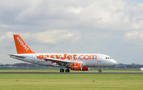 Schiphol, The Netherlands - April 8, 2016: EasyJet Airbus A319 landing at Amsterdam Airport Schiphol. The G-EZSM is part of the fleet of EasyJet, the British low-cost airline carrier easyJet.