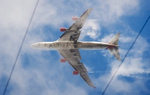 A Virgin Atlantic passenger plane comes into land at Heathrow airport in west London on December 21, 2012. AFP PHOTO/LEON NEAL        (Photo credit should read LEON NEAL/AFP/Getty Images)