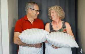 Michael and Debbie Campbell carrying pillows