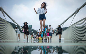 Tourists on the glass bridge.