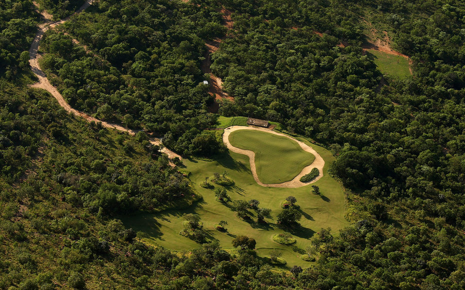 ENTABENI, SOUTH AFRICA - JANUARY 07:  A view of the Extreme 19th hole from the tee, Par 3 631m long, where the tee is at the top of Hanglip mountain and the green is the shape of Africa at the Legend Golf Course on the Entabeni Safari Reserve on January 7