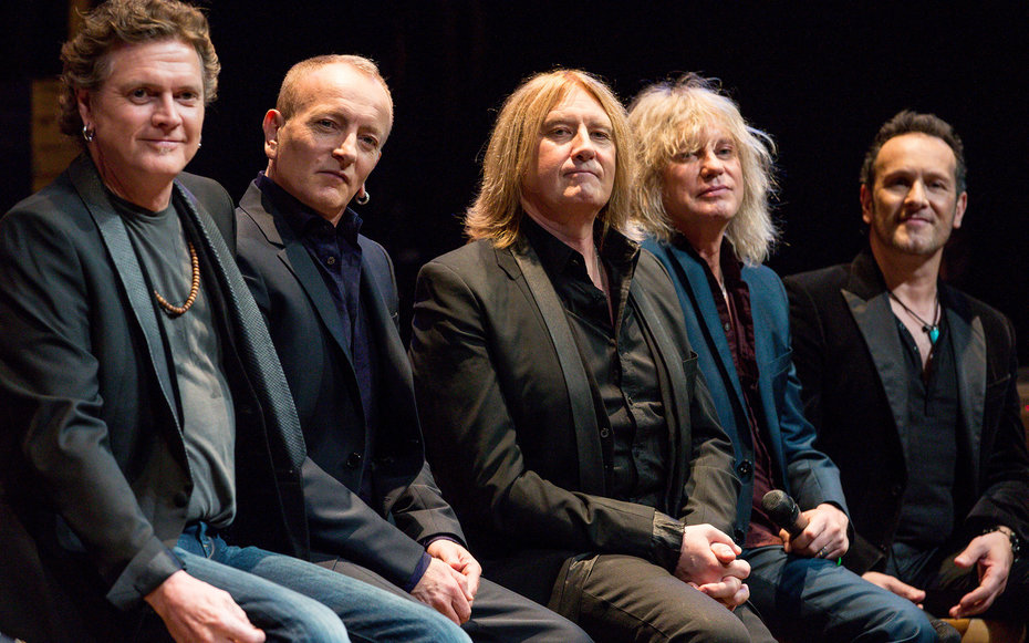 WEST HOLLYWOOD, CA - MARCH 17:  (L-R) Musicians Rick Allen, Phil Collen, Joe Elliott, Rick Savage and Vivian Campbell of Def Leppard appear at a press conference to announce the KISS and Def Leppard '2014 Heroes Tour' at House of Blues on March 17, 2014 i