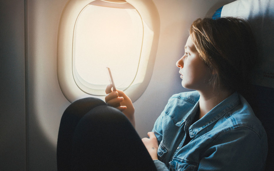 Woman at Airplane Window