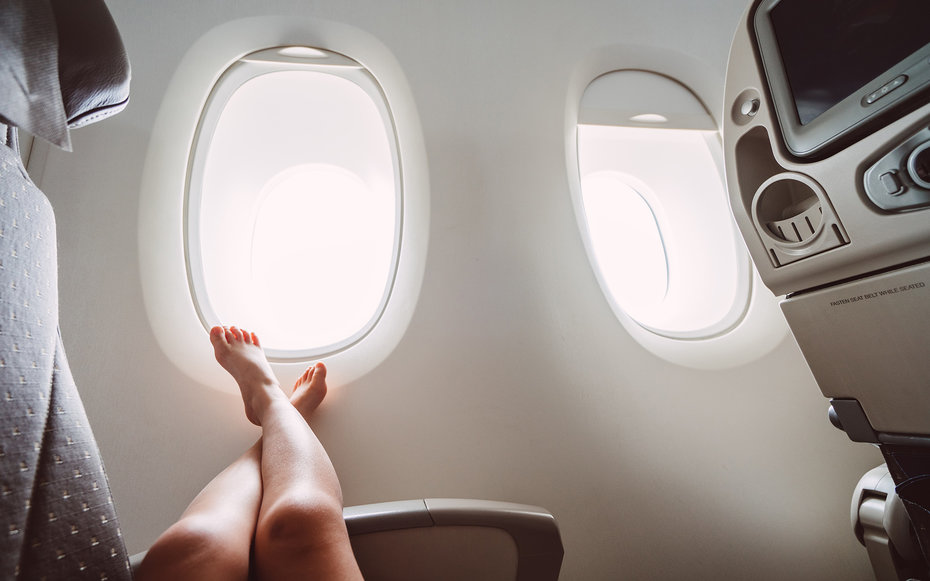 Little girl relaxing in the airplane