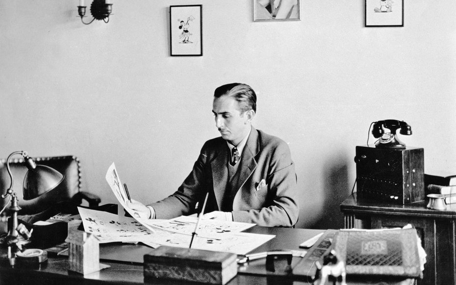 Walt Disney at his office desk.