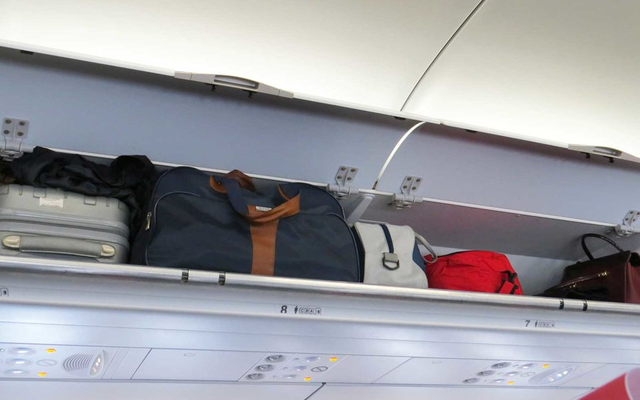 How To Put Your Luggage In The Overhead Bin According To