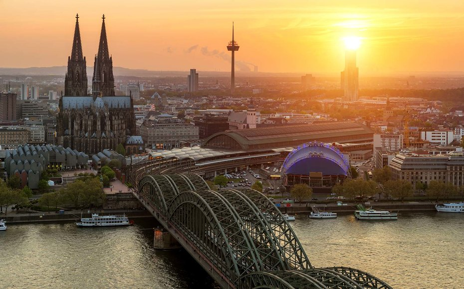 Cologne Cathedral and Rhine river during sunset in Cologne, Germany.
