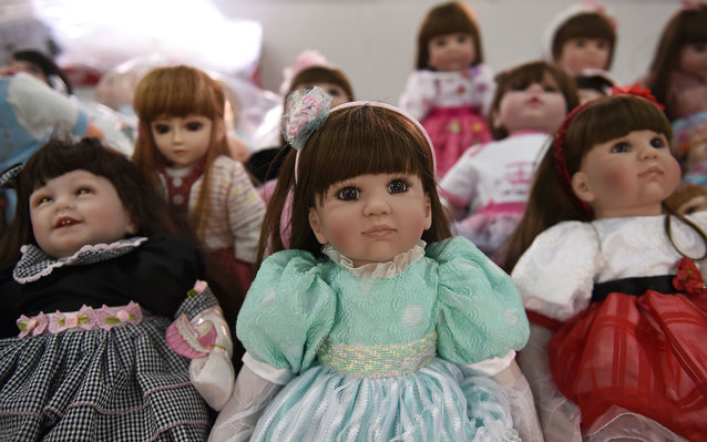 """""""Luuk thep"""" (child angels) dolls are displayed at the Economic Crime Suppression Division after more than a hundred of them were seized in separate raids, in Bangkok on January 26, 2016. A craze in Thailand for pampering lifelike dolls to bring good fort"""